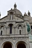 Basilica of the Sacred Heart Sacre Coeur. Paris, France, Montmartre. Facade with statues, archs, dome and towers. Rainy day, gre stock image