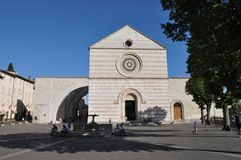 Basilica of Saint Clare, Assisi. Tourists in front of the Church of St Clare (Basilica di Santa Chiara) in Assisi, Umbria, Italy Stock Image