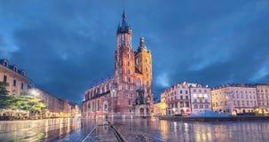 Basilica of Saint Mary at dusk in Krakow, Poland. Basilica of Saint Mary at dusk with reflection in Krakow, Poland static image with animated sky stock footage