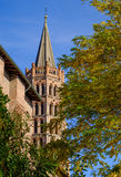 Basilica of Saint Sernin steeple and fall foliage in Toulouse Royalty Free Stock Photos