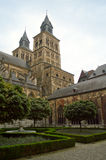 Basilica of Saint Servatius. View of the Basilica of Saint Servatius in Maastricht (Netherlands) from the lateral cloister. The romanesque church, located next Stock Photos