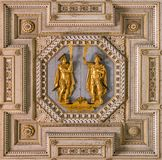 Detail from the ceiling of the Basilica of Saints John and Paul with the saints statues. Caelian Hill in Rome, Italy.
