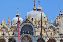 Basilica of San Marco in Venice, Italy. Detail of the basilica of San Marco on Saint Mark`s Square in Venice, Italy. Tourists on the external walkway. Europe Stock Photography
