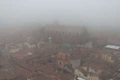 Basilica of San Petronio in a foggy day. View from Asinelli Tower. Emilia Romagna , Italy. Royalty Free Stock Photo