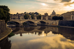 Basilica San Pietro as seen from the St. Angelo bridge. Basilica San Pietro in background, with the bridge Ponte Vittorio Emanuelle II and river Tiber in Stock Photos