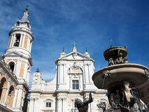 The Basilica of the Sanctuary of the Holy House of Loreto in Ita. The facade of the Basilica of the Sanctuary of Loreto, the bell tower and the fountain. Marche royalty free stock image