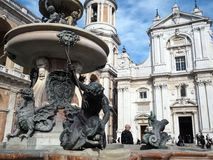 The Basilica of the Sanctuary of the Holy House of Loreto in Ita. The facade of the Basilica of the Sanctuary of Loreto, the bell tower and the fountain. Marche stock image