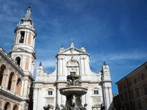The Basilica of the Sanctuary of the Holy House of Loreto in Ita. View of the Facade of the Basilica and Bell Tower of the Sanctuary of Loreto. Marche region royalty free stock photography
