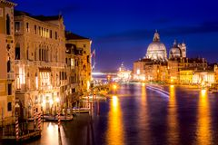 Basilica Santa Maria della Salute, Punta della Dogona and Grand Canal at blue hour sunset in Venice, Italy with reflections.  stock images