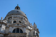 The Basilica Santa Maria della Salute in Venice, Italy. The church against the blue sky Royalty Free Stock Photography