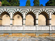 Basilica of Santa Maria Novella - Firenze Italy. Perimeter wall of the cloister of the Basilica of Santa Maria Novella in white marble and green serpentine in Royalty Free Stock Images