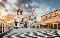 Basilica of St. Francis of Assisi at sunset, Assisi, Umbria, Italy. Famous Basilica of St. Francis of Assisi (Basilica Papale di San Francesco) with Lower Plaza Royalty Free Stock Image