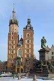 Basilica of St.Mary - Krakow - Poland. The Gothic Basilica of St.Mary and the statue of Adam Mickiewicz in the main market square (Rynek Glowny) in Krakow in Stock Photo