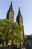 Basilica of St Peter and St Paul with the associated historic cemetery. Basilica of St Peter and St Paul is neo-Gothic church in Vysehrad fortress,Prague, Czech Royalty Free Stock Photos