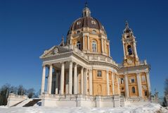Basilica of Superga with snow and sun. Photo made at the Basilica of Superga (Italy) with snow on the ground. Superga is one of the highest hills (672 m asl) in Royalty Free Stock Images