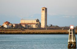 Basilica of Torcello view from Burano in Venice in Italy Royalty Free Stock Image