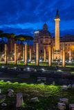 The Basilica Ulpia  and the Trajan`s Column at night in Rome, Italy. Royalty Free Stock Photos