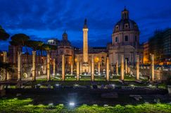 The Basilica Ulpia  and the Trajan`s Column at night in Rome, Italy. Stock Images