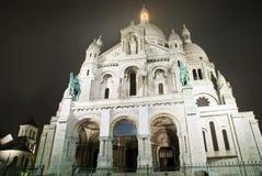 Basiliek Sacre Coeur bij nacht Stock Afbeeldingen