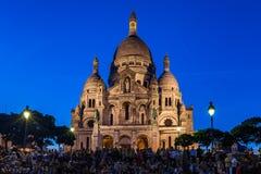 Basilika av Sacren Coeur överst av den Montmartre kullen i Paris, Arkivfoto