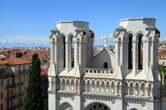 Basilique Notre Dame de Nice and red tile roofs in the centre of Royalty Free Stock Photography
