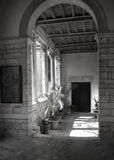 Basillica entry in Pula, Croatia. Black and white image of an entry to the Basillica in the center of Pula, Croatia royalty free stock photography