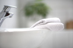 Basin. A washbowl and two towels Stock Photos