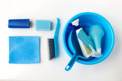 Basin with cleaning stuff on white background Royalty Free Stock Photo