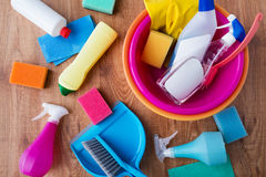 Basin with cleaning stuff on wooden floor Royalty Free Stock Photos