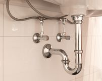 Basin siphon or sink drain in a bathroom. Clean Royalty Free Stock Photography