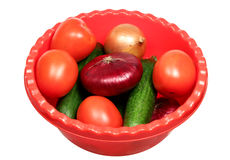Basin with vegetables on a white background Stock Image