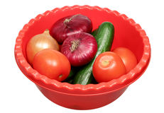 Basin with vegetables on a white background Royalty Free Stock Image