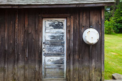 Basin and Weathered Door Royalty Free Stock Images