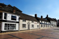Cross St Shops. Basingstoke, United Kingdom - July 05 2018: A row of businesses in Cross Street Royalty Free Stock Photo