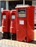 Post box line up. Basingstoke, United Kingdom - July 05 2018: Three posts boxes, two for letters and one for parcels, in London Street royalty free stock photo