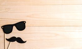 Basis for banner with mustache props and glasses for photos. Frame for text with paper mustache and glasses. Frame for children`s stock images