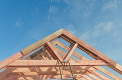 Construction of wooden frame house. Basis, a frame of the wooden house, fastening of overlapping of a roof Stock Photo