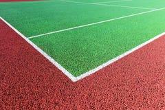 Basislijn op groene harde tennisbaan Stock Foto