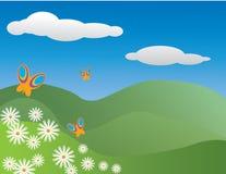 Basisrecheneinheiten und Gänseblümchen in einer hilliside Wiese Stockfotografie