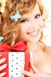 Basisrecheneinheitsmädchen mit Geschenk Stockbilder