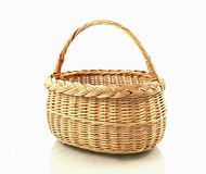 Basket. Yellow wood basket on white background Stock Photos