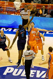 Basket. VALENCIA, SPAIN - JANUARY 28: Cedric Simmons (Blue) and Victor Claver (orange) starting the match between Valencia Basket and Asefa Estudiantes, 85-71 Royalty Free Stock Photography