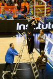 Basket. VALENCIA, SPAIN - JANUARY 28: Several operators repairing the basket during the ACB league match between Valencia Basket  and Asefa Estudiantes, 85-71 Royalty Free Stock Photos