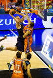 Basket. VALENCIA, SPAIN - JANUARY 28: Daniel Clark (blue shirt) slam dunk during the ACB league match between Valencia Basket  and Asefa Estudiantes, 85-71, on Stock Images