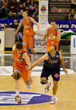 Basket. VALENCIA, SPAIN - JANUARY 28: Carlos Jimenez (blue) and Victor Claver (orange) in action during the league match between Valencia Basket and Estudiantes Royalty Free Stock Photo