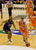 Basket. VALENCIA, SPAIN - JANUARY 28: Nando De Colo (#22) in action with the ball during the ACB league match between Valencia Basket  and Asefa Estudiantes, 85 Royalty Free Stock Photos