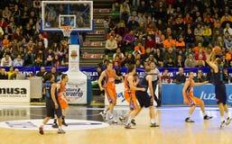 Basket. VALENCIA, SPAIN - JANUARY 28: Carlos Jimenez (blue shirt #10)  three-point shot during the league match between Valencia Basket  and Asefa Estudiantes Stock Images