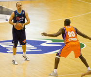 Basket. VALENCIA, SPAIN - JANUARY 28: Carlos Jimenez (blue shirt) in action during the ACB league match between Valencia Basket  and Asefa Estudiantes, 85-71, on Royalty Free Stock Photo