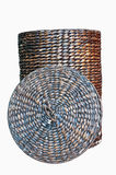Basket. Aging braided basket with lid with insulation on white background Royalty Free Stock Photos