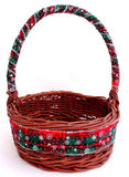 Basket. Decorated with patterned Christmas ribbon on white background Royalty Free Stock Photography